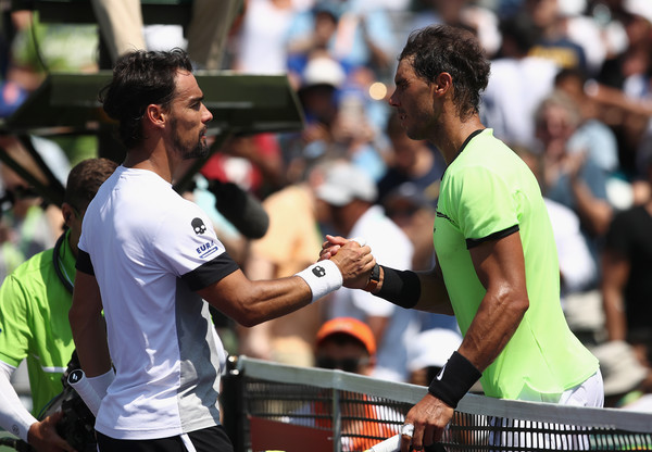 Rafael Nadal skakes hands with Fabio Fognini at the net.