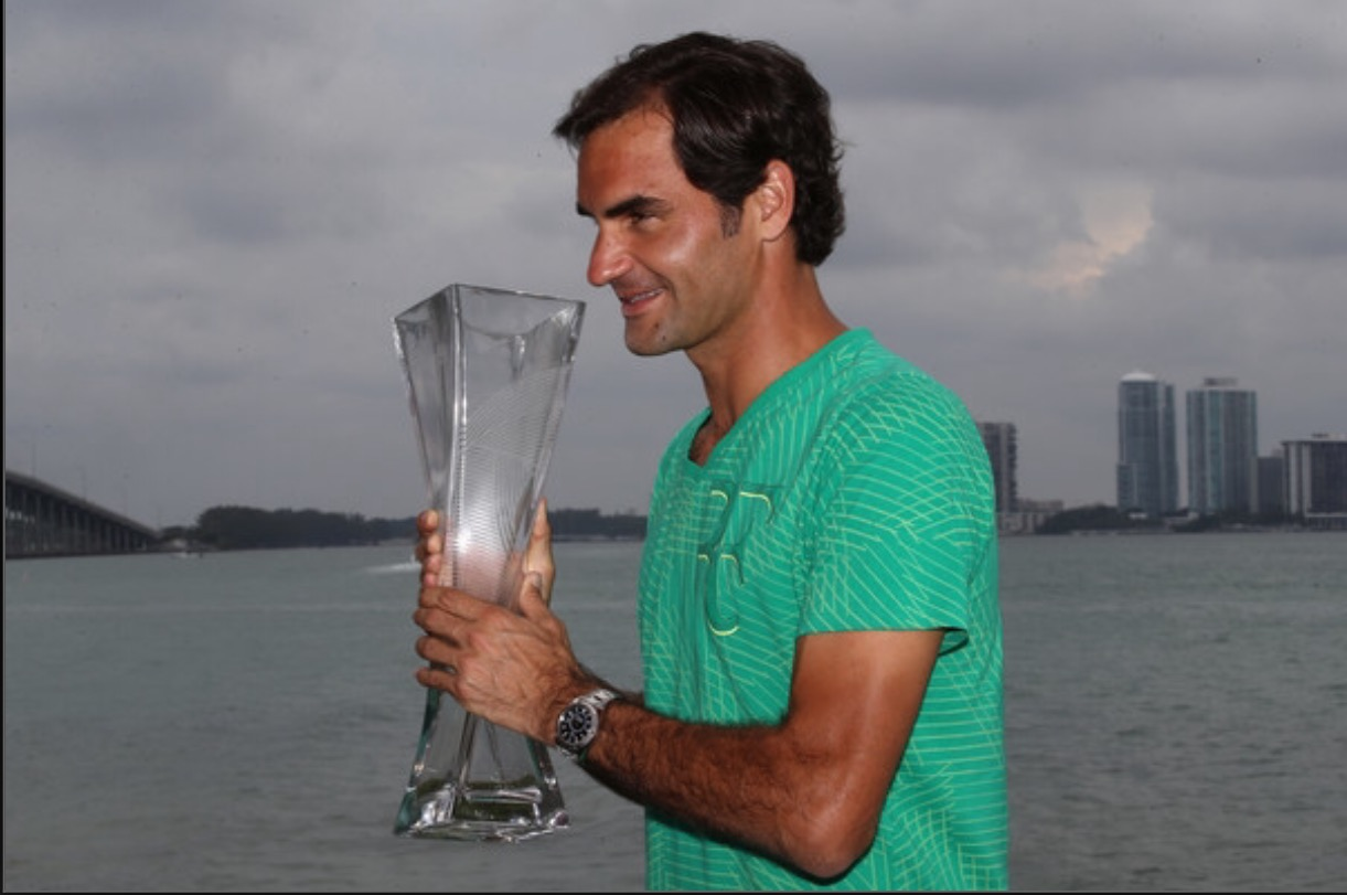 Roger Federer lifts the Miami Open trophy